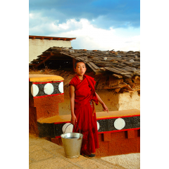 Young Monk Gets Water